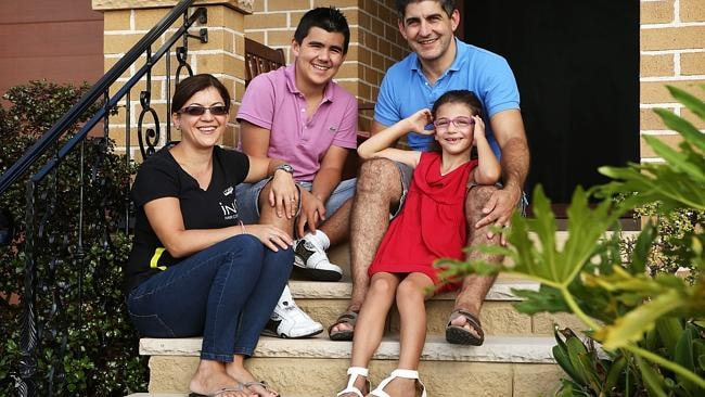 Tony Di Quattro (43), wife Lina and kids Danny (14) and Kiara (6) pictured at their home in Merrylands.