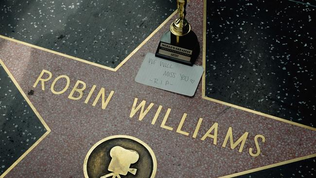 "A minature Oscars statue and an ""I will miss you"" note is seen at Robin Williams' star on the Hollywood Walk of Fame is seen, August 11, 2014, in Hollywood, California."
