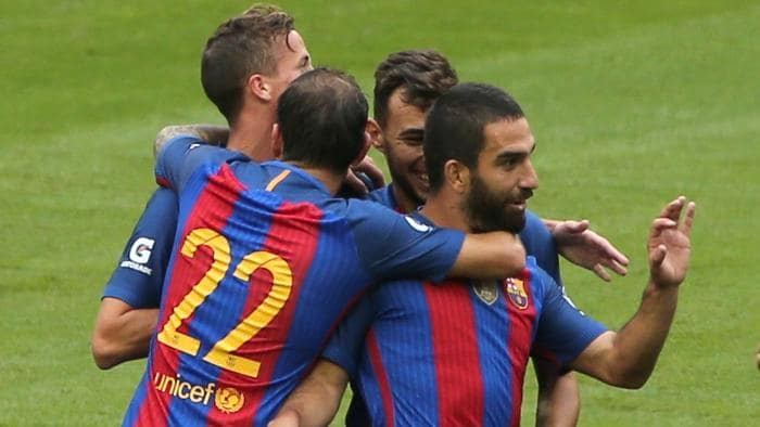 IMAGE DISTRIBUTED FOR INTERNATIONAL CHAMPIONS CUP - Barcelona's Arda Turan is congratulated by captain Lionel Messi after Turan scored the first goal, on Saturday, July 30, 2016, in Dublin. (Peter Morrison/AP Images for International Champions Cup)
