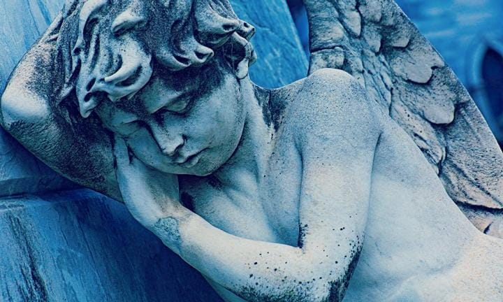 Young sleeping, sad and fragile Angel , Recoleta cemetery, Buenos Aires