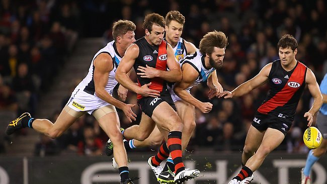 MELBOURNE, AUSTRALIA - JULY 07: Jobe Watson of the Bombers is bumped by Justin Westhoff of the Power which injures his shoulder during the round 15 AFL match between the Essendon Bombers and Port Adelaide Power at Etihad Stadium on July 7, 2013 in Melbourne, Australia. (Photo by Quinn Rooney/Getty Images)