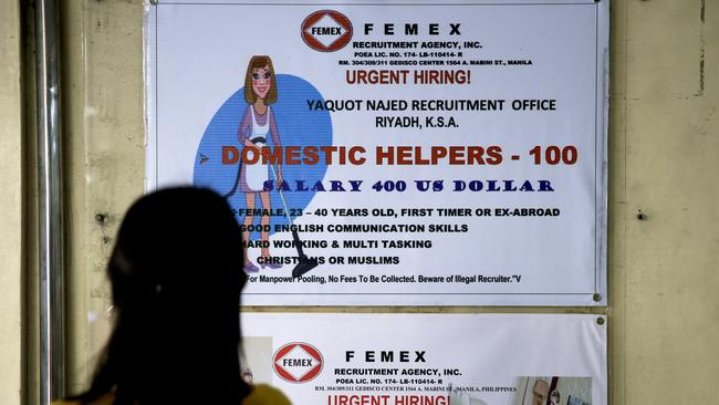 Help wanted signs outside a recruitment agency in Manila. Picture: Aaron Favila/AP