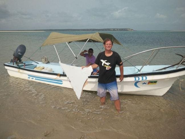 Blaine 'Indiana Jones' Gibson with the suspected MH370 debris he found at the weekend. Picture: Blaine Alan Gibson