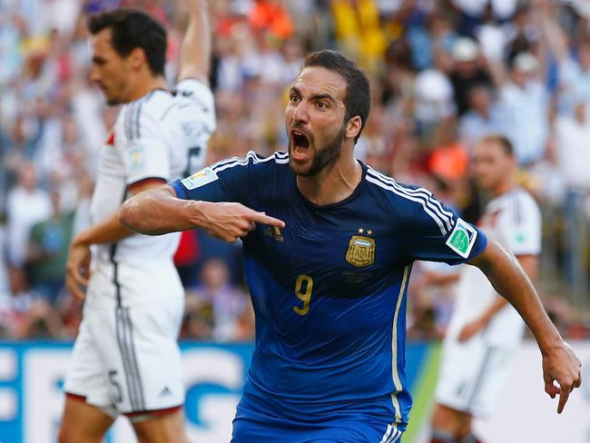 Gonzalo Higuain of Argentina celebrates scoring a disallowed goal past Manuel Neuer of Germany during the first half.