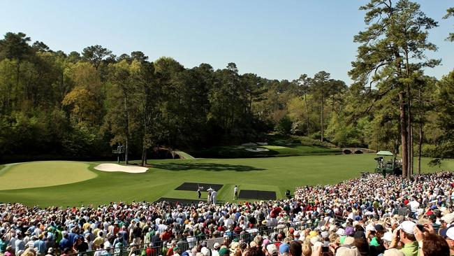 Tiger Woods hits his tee shot on the 12th during a practice round at Augusta.