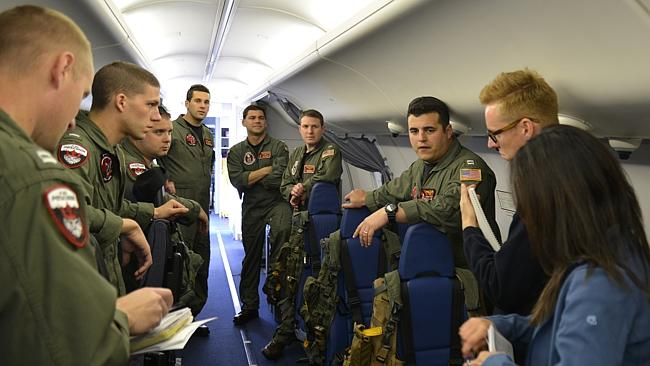 Lieutenant Clayton Hunt, Patrol Squadron (VP) 16, talking to his crew and media on board P-8A Poseidon before it left Perth International Airport yesterday. 2nd Class Eric A. Pastor