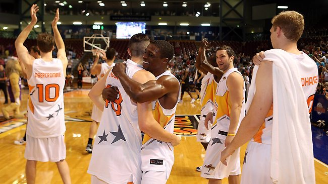 Jonny Flynn, centre, celebrates with his South teammates after North was defeated in the NBL All-Star game at Adelaide Arena.