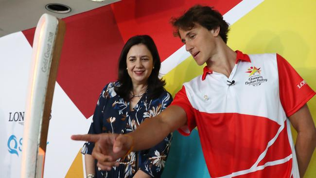 Games ambassador and Olypmic swimmer Cam McAvoy shows off the baton to Premier Annastacia Palaszczuk this morning. Picture: Peter Wallis