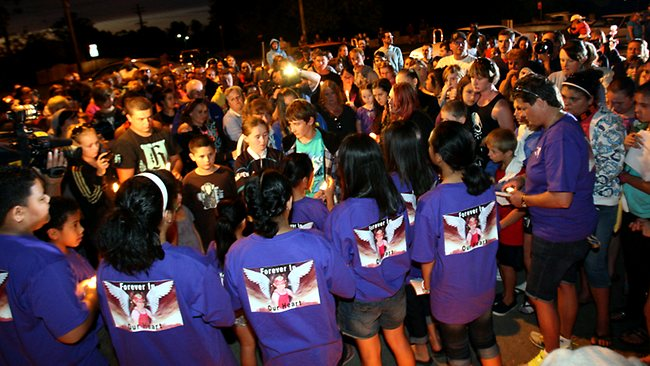 NEWS: Friends, family & members of the public hold a candle light vigil at the shrine honouring murdered Mount Druitt 6 year old Kiesha Abrahams. Her mother Kristy Abrahams & stepfather Robert Smith were arrested & charged with her murder overnight. Family & friends who formed the group A Voice for Kiesha wearing purple t-shirts sing songs & read poems.