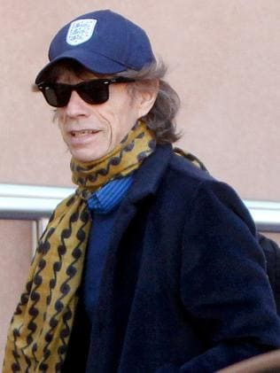 An hour of privacy ... Mick Jagger leaves the Intercontinental Hotel in Adelaide. Picture: Calum Robertson