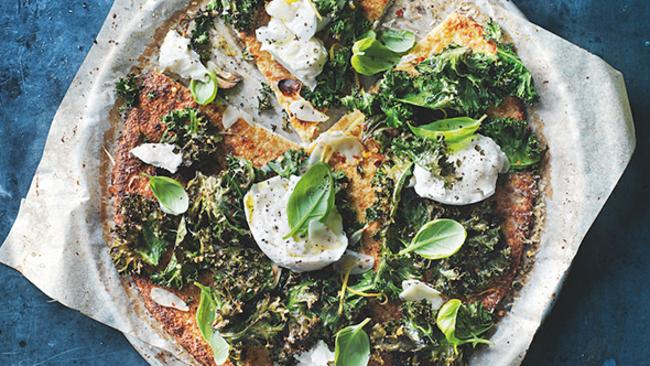 Cauliflower pizza with kale, mozzarella and lemon.