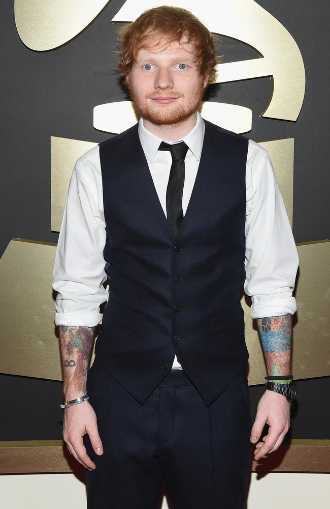 Showing off his tatts ... Recording Artist Ed Sheeran arrives on the red carpet.