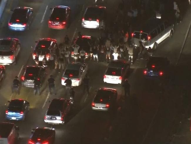 Police try to disperse protesters. Picture: CBS12.com