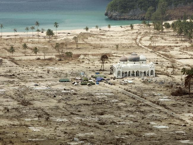 The Rahmatullah Lampuuk Mosque stands intact after the 2004 tsunami hit the area in Lhoknga, near Banda Aceh, Indonesia. Picture: AP / Greg Baker