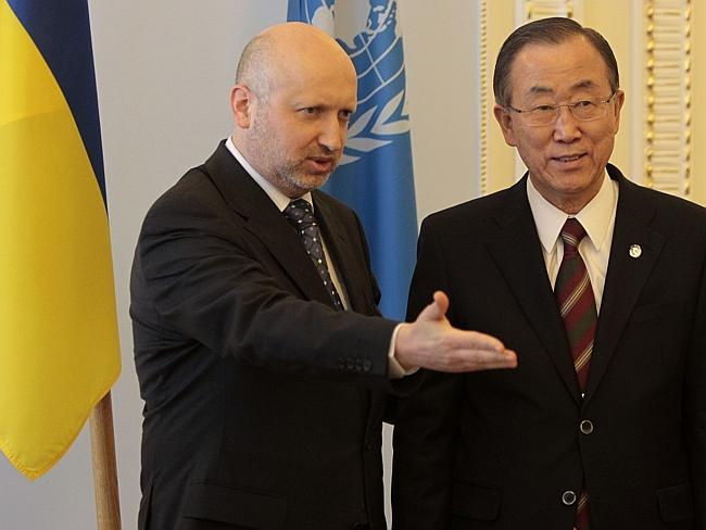 Diplomacy ... acting Ukrainian President Oleksandr Turchynov (left) welcomes UN Secretary-General Ban Ki-moon during a meeting in Kiev, March 21, 2014. Picture: Sergei Chuzavkov