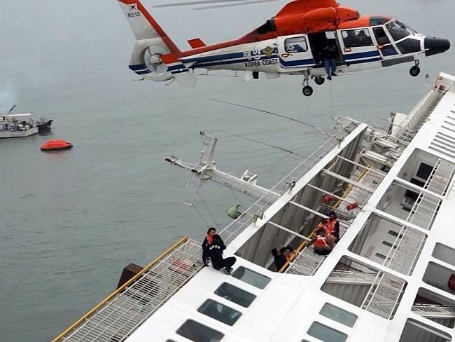 Clinging to the side hoping to be rescued ... South Korea Coast Guard members in helicopters trying to rescue some of the 477 passengers and crew aboard a South Korean ferry that capsized on its way to Jeju island from Incheon.