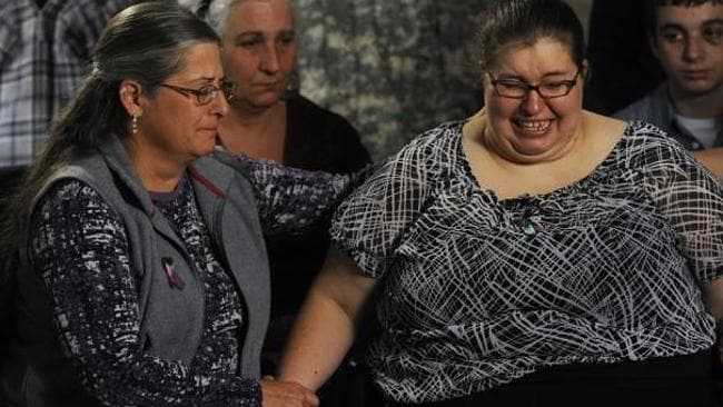Jessica's mother Sarah Ridgeway is comforted by her aunt Gay Moore (left) at the Westminster Police Department i...