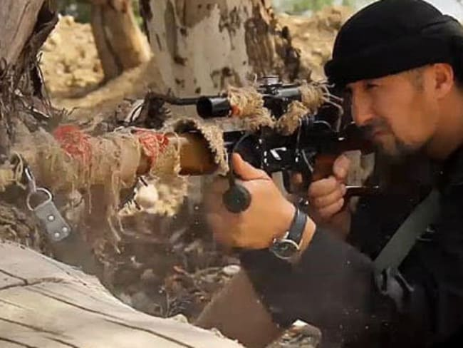 The Colonel shows of his sniper skills in an IS made video released last year in which he declared he was 'bringing jihad to Russia, Tajikstan and the US'.
