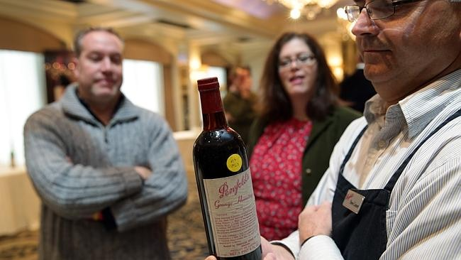 Penfolds Steve Lienert with a bottle of Grange from 1964 that belongs to Kevin and Alison Gray (in the background). Picture: Ella Pellegrini