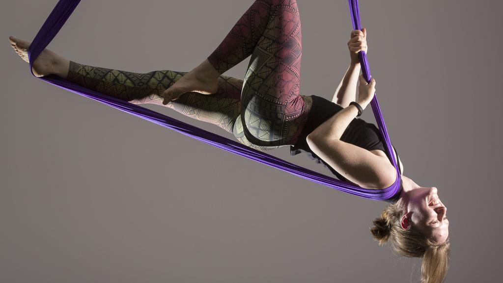 Emily Williams from Alternative Yoga NT performing an aerial staff pose. Picture: GLENN CAMPBELL