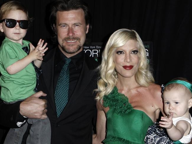 Tori Spelling, second from right, and her husband, Dean McDermott, second from left, pose with their children, Liam, far left, and Stella in 2009.