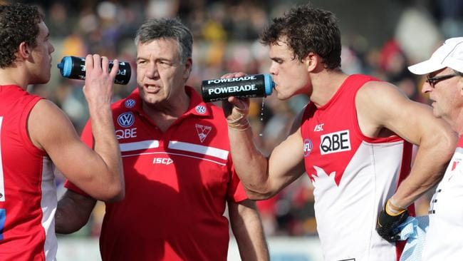 Shane Mumford, Steven Taubert and Mike Pyke talk strategy. Picture: AFL Media