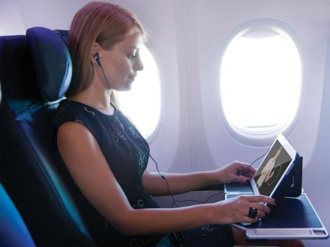There have been about 50,000 enrolments in short courses offered on Virgin Australia flights in conjunction with Open Universities Australia.