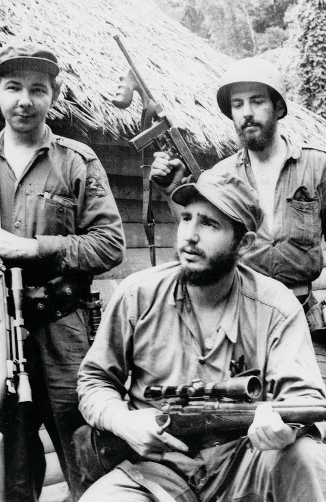 Fidel Castro, the young anti-Batista guerilla leader, with his brother Raul Castro and Camilo Cienfuegos while operating in the Mountains of Eastern Cuba. Picture: AP