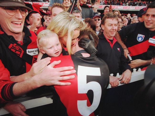 Hird is embraced by his wife Tania and daughter Stephanie after the 2000 Grand Final.