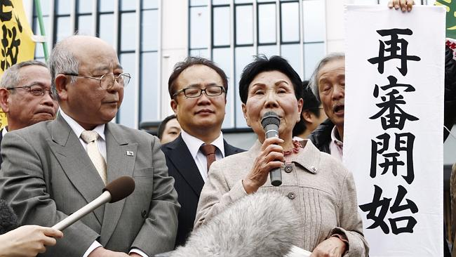 Hideko Hakamada speaks to supporters of her brother outside the Sizuoka District Court in western Tokyo after the court granted a retrial.