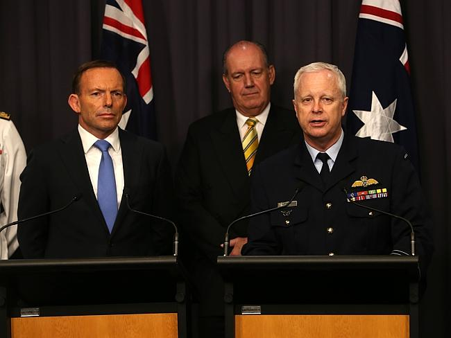 """Very important promotion"" ... PM Tony Abbott and Defence Minister David Johnston during a press conference at Parliament House in Canberra to announce the new ADF Chief, Air Marshal Mark Binskin."