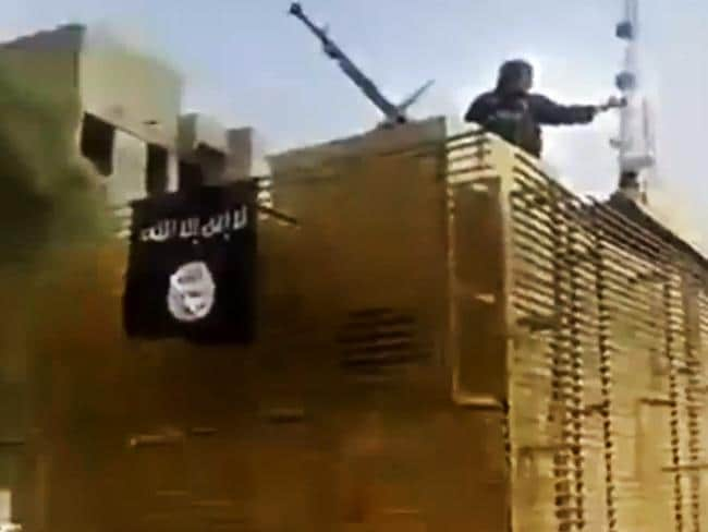 Gaining power ... footage from an ISIS militant social media account, which has been authenticated based on its contents and other AP reporting, shows militants arriving at the country's largest oil refinery.
