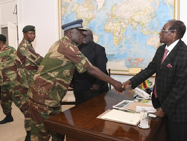Zimbabwean President, Robert Mugabe, right, meets with the military in Harare. A proposed address to the nation was delayed. Picture: Zimbabwe Herald via AP