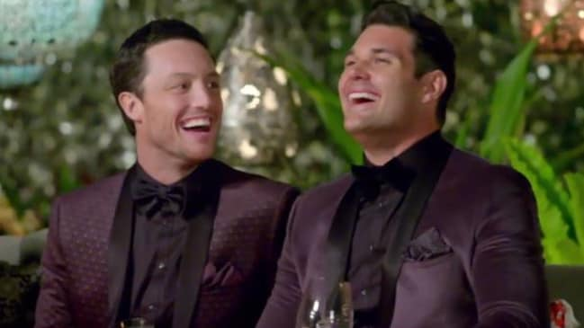 Grrr there's just something about two men in a shiny purple suit you know what I mean?