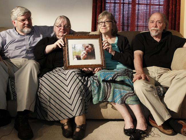 Patrick Boyle, (l-r) Linda Boyle, Lyn Coleman and Jim Coleman hold a photo of their kidnapped children, Joshua Boyle and Caitlan Coleman, who were kidnapped in late 2012. Picture: AP