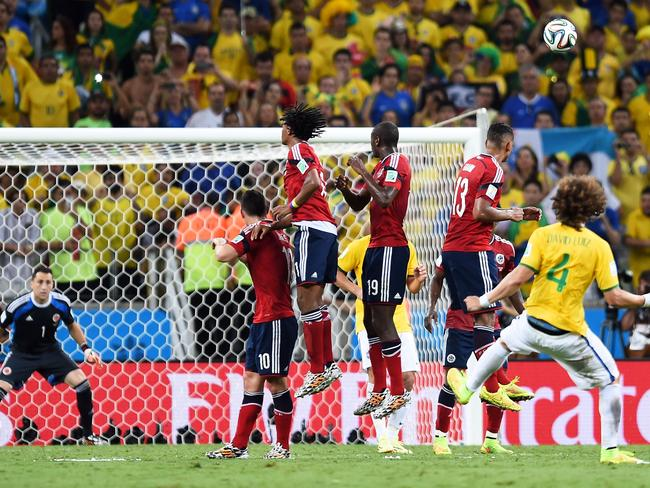 David Luiz of Brazil scores his team's second goal from a magical free kick against Colombia in the 2014 World Cup quarter-final.