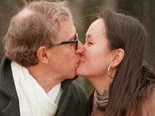 Actor director Woody Allen (l) kissing with wife Soon-Yi Previn 26 Dec 1997.