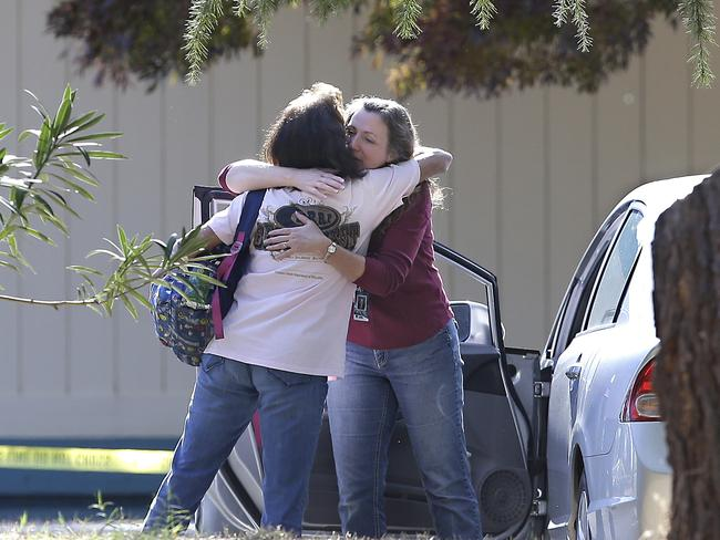 Two women embrace outside Rancho Tehama Elementary School. Picture: AP Photo/Rich Pedroncelli