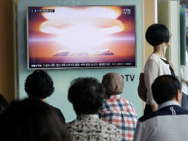 People at Seoul Railway Station watch a TV news program reporting a North Korean nuclear test. Picture: AP /Ahn Young-join