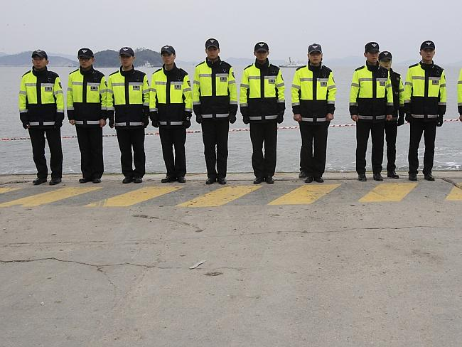 Human barricade ... police officers stand in line in order to prevent the deaths of relatives of the missing ferry passengers, who are threatening to swim to the ship wreck site and find their family members by themselves. Picture:Ahn Young-joon
