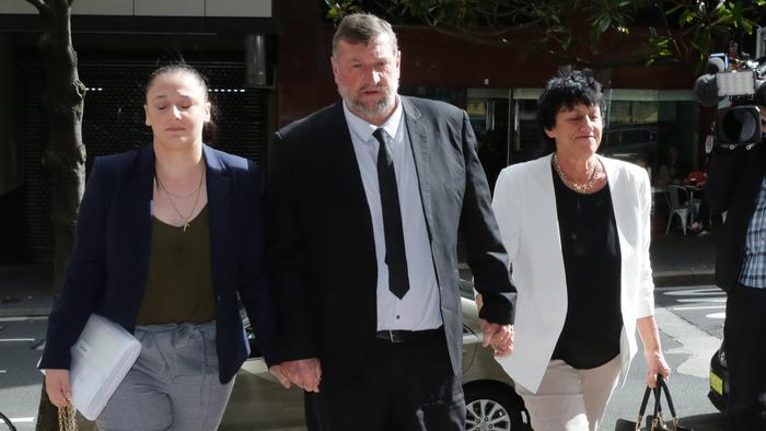 Greg and Virginia Hughes and their daughter Megan arrive at the Downing Centre this morning, ahead of day four of the inquest. Picture: Ross Schultz