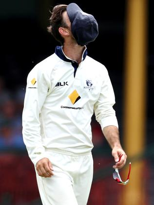 Glenn Maxwell puts his cap over his face. Picture: Gregg Porteous