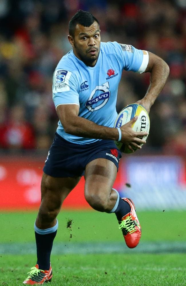 Kurtley Beale, who has been of the Waratahs' best players recently, makes a break against the Reds.