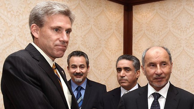 US ambassador J. Christopher Stevens, pictured in June with Libyan National Transitional Council chairman Mustafa Abdel Jalil, has been killed in a mob attack. Three officials were also killed in the attack on the US consulate in the eastern city of Benghazi.