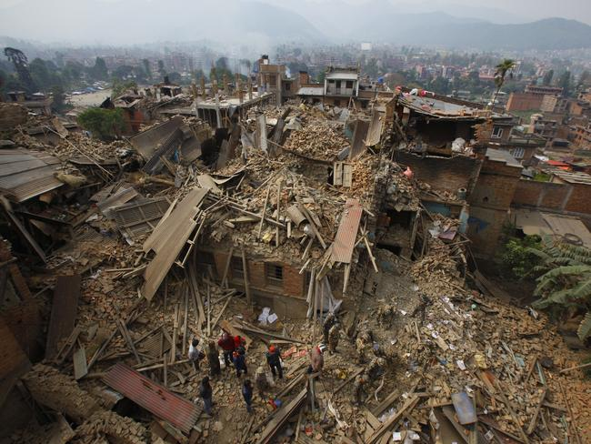Collapse ... many houses, buildings and temples in Kathmandu were destroyed, leaving hundreds dead or trapped under the debris. Picture: AP Photo