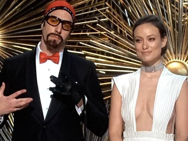 Olivia Wilde and Sacha Baron Cohen as Ali G.
