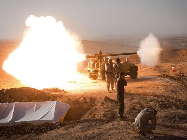 Iraqi Kurdish Peshmerga fighters fire a recoilless rifle towards Islamic State fighters. AFP PHOTO/ JM Lopez