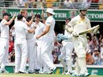 England players celebrate after Chris Rogers out caught by Michael Carberry off the bowling of Stuart Broad.