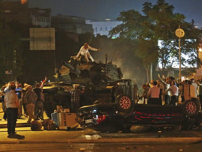 Tanks move into position as Turkish people attempt to stop them in Ankara. Picture: AP