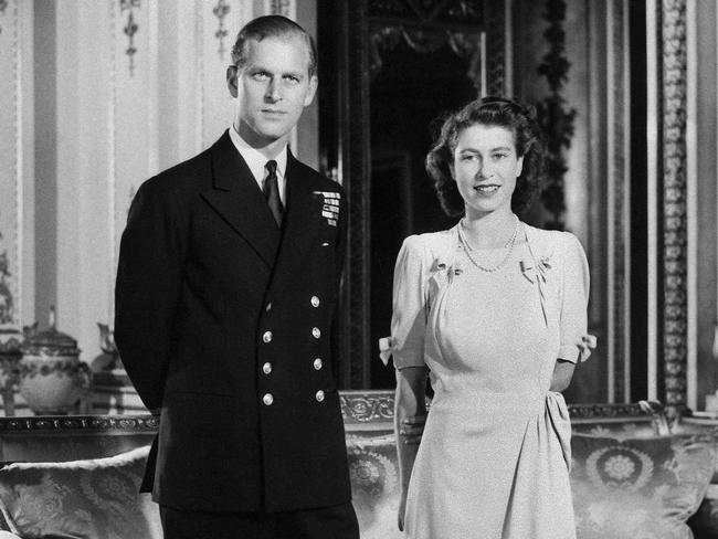 Princess Elizabeth (future Queen Elizabeth II) and her fiance Philip Mountbatten pose in Buckingham Palace, London, on the day their engagement was officially announced. Picture: AFP Photo
